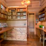 modern simple wooden house computer shelves drawers wood floor walls chairs hanging lamp books