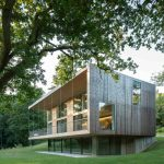 modern simple wooden house grass trees three story building glass contemporary exterior windows