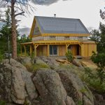 Modern Simple Wooden House Yellow Wood Exterior Roof Door Windows Rocks Trees