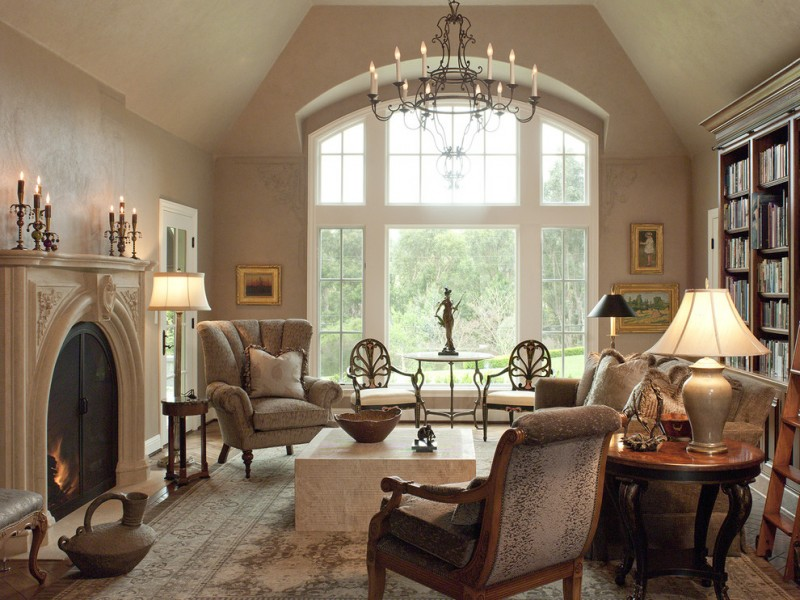 morning room designs fireplace carpet lamps table chairs bookshelves books ladder traditional style big windows chandelier
