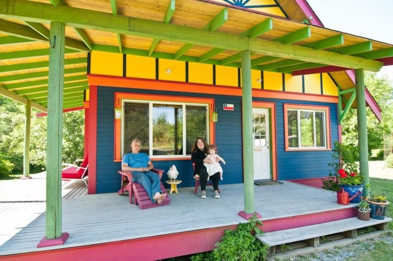most beautiful exterior of house color combinations blue yellow green red flowers windows door chairs eclectic look