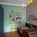 Multicolored Wall Painting Idea For Kids Room Three Pendant Lamps With Colorful Shades Simple Wood Shelves Mounted On Wall Small Yellow Chair Medium Toned Wood Floors