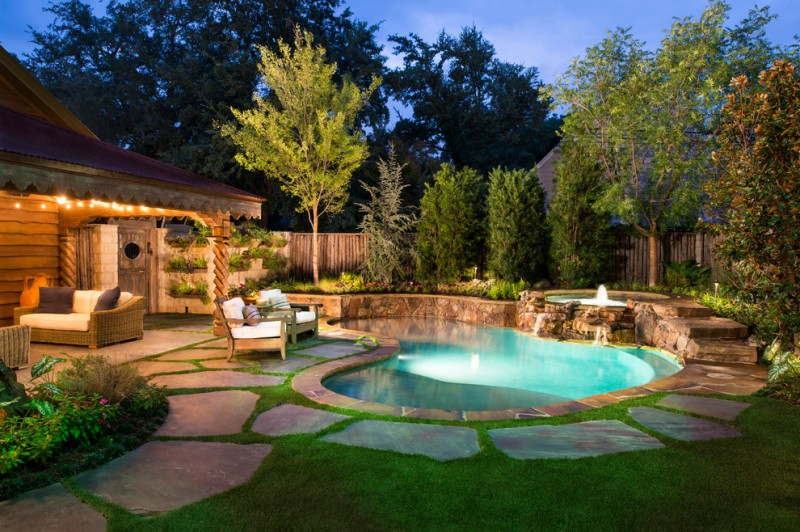 oasis small pool hot tub concrete pavers wooden sofas green grass