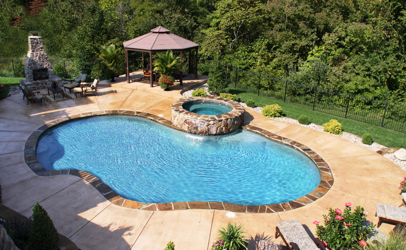 outdoor japanese style hot tub near swimming pool