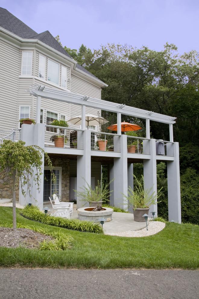 outdoor metal railing with flower design idea chairs big pots flowers pillars windows