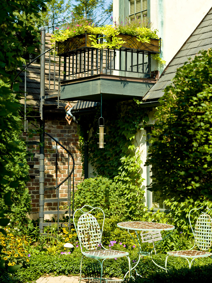 outdoor metal railing with flower design ideas chairs table brick wall plants flowers roof