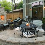 Patio With Pavers In The Color Of Sierra, Fireplace, Rattan Table Set Furniture