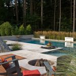 Patio With Pool, Fire Pit On One Side On Wooden Deck, Black Chairs,