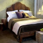 Reclaimed Pine Bed Frame Design With Headboard In Antique Look Concrete Floors Concrete Walls Tree's Trunk Bedside Tables