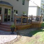Redwood Deck With Redwood Deck Skirt And Black Aluminum Railing System Grey Siding Exterior Idea For Cottage