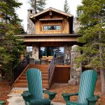 rustic deck and patio with vertical wood skirting and black iron railing system modern green rocking chairs for patio