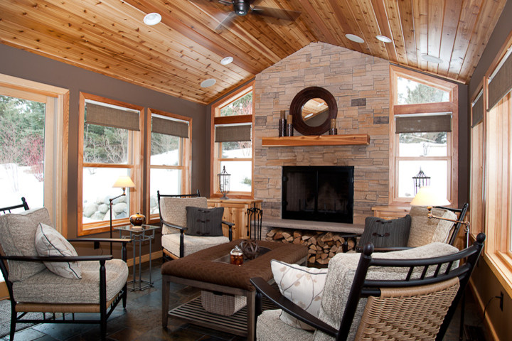 rustic four season porch rectangular ottoman with tray insert fire place cofmortable chair cool flooring bright colourceiling