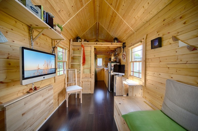 rustic house trailer with attic bedroom, kitchen, bathroom, home office area, living room and all furniture is made of light brown wood