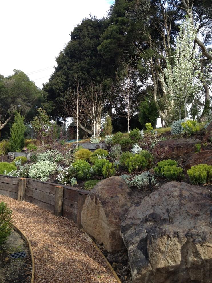 rustic landscape with big stones, flowers, plants