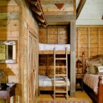 rustic mud wood interior bedroom mirror table beds pillows ladder carpet lamp traditional design