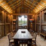 rustic mud wood interior dining room lighting lights table chairs windows logs bench