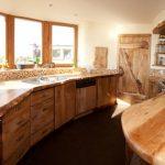 rustic mud wood interior kitchen windows wall tile wood countertop door shelves