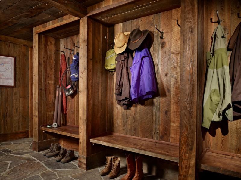 rustic mud wood interior mudroom stone floor painting clothes racks entry room