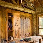 rustic mud wood interior stone floor bench storage clothes rack door hanging lights