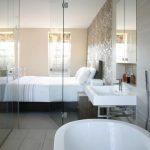 simple glass door for bedroom bathtub faucet wash basin towel rack bed pillows windows floor tile