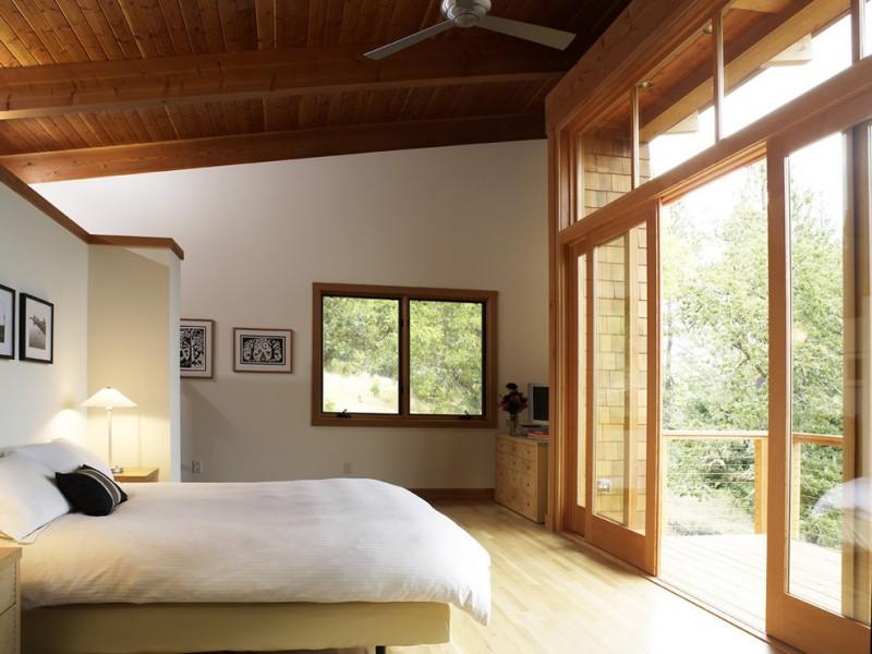 simple glass door for bedroom wood ceiling bed pillow painting lamp sliding doors window ceiling fan wood floor railing