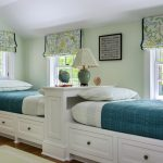 Simple Room With White Ceiling And Wall, Wooden Flooring, White Rud, White Long Twin Bedding With Cabinet Under And Headboard Separates The Bed