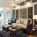 Simple Traditional Sunroom With Rattan Furniture With Brown Cushions, Ottoman As Coffee Table, Table Lamp