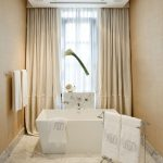 Simple White Small Bahtub In A White Large Bathroom