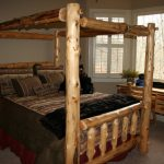 Sleek Log Bed Model In Rustic Traditional Style Warm Cream Area Rug Log Working Table And Chair Hardwood Bedside Table With Table Lamp