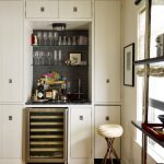 Small Bar In The Kitchen Cabinet With Black Marble Top, Glass Shelves On Top