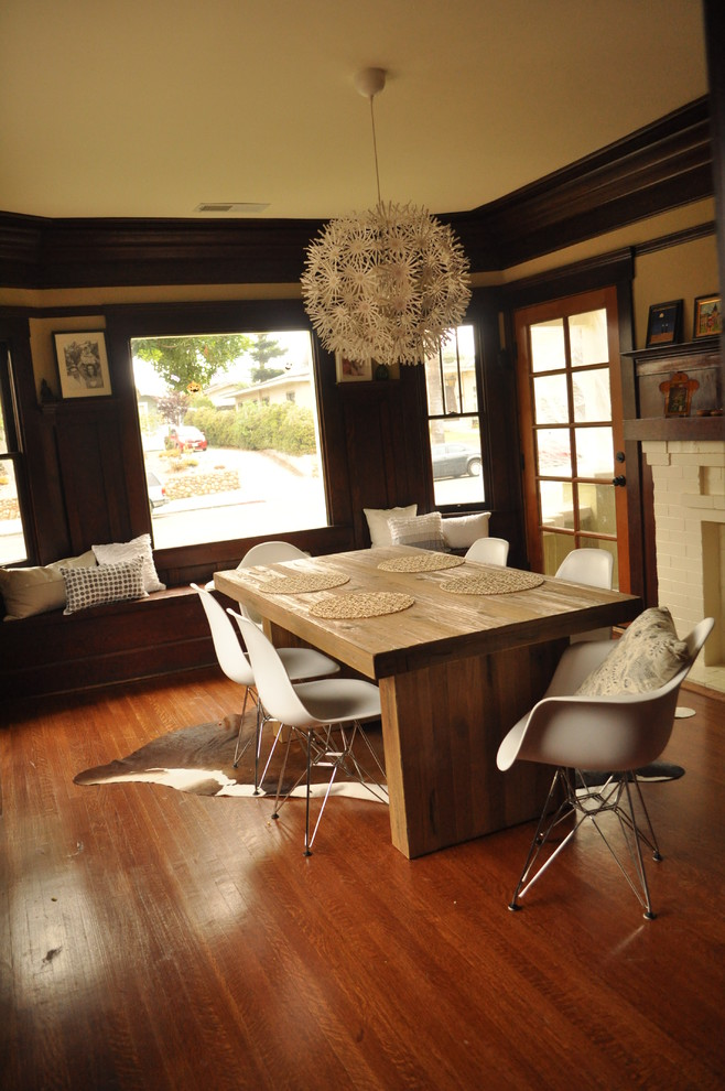 smooth handcrafted dining table white industrial chairs with aluminum base modern ball hang lamp in white dark toned wood floors