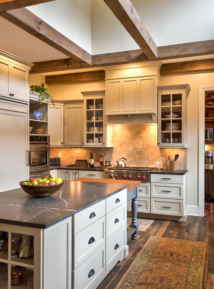 soapstone kitchen island carpet cabinets shelves hardwood floor farmhouse kitchen lamps