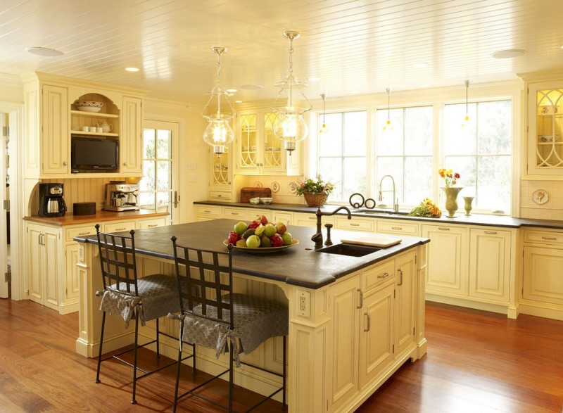 soapstone kitchen island hardwood floor cabinets window dining chairs ceiling lamps beautiful hanging lights