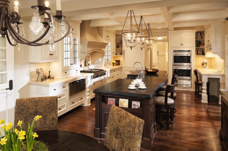 soapstone kitchen island hardwood floor elegant traditional design chandelier bookshelves wall cabinet chair door lights dining chairs