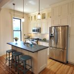 soapstone kitchen island interesting wood floor backless dining chairs ceiling lights hanging lamps cabinets