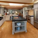 Soapstone Kitchen Island Traditional Kitchen Windows Wood Floor Faucet Sink Chairs Pillows Wall Cabinet