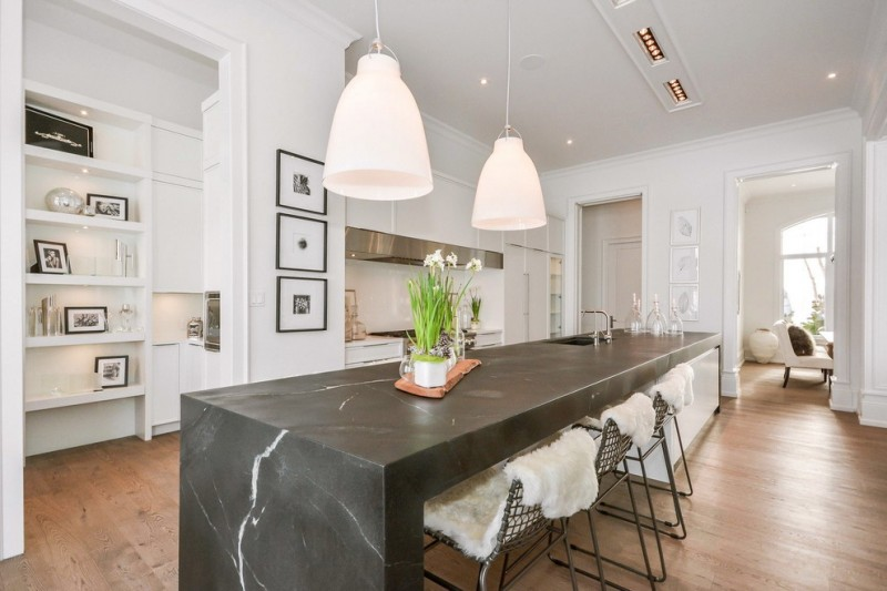 soapstone kitchen island transitional kitchen wood floor shelves dining chairs hanging lamps ceiling lights wall decor