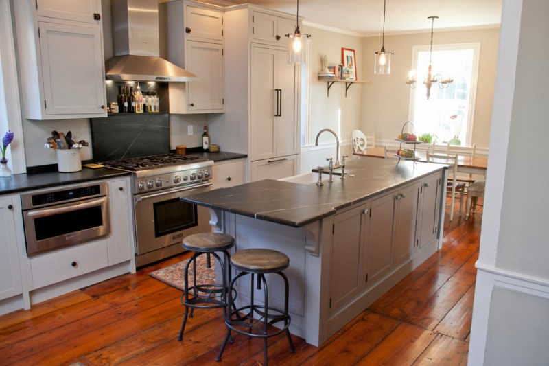 soapstone kitchen island wall cabinet wood floor window appliances farmhouse kitchen stools dining chairs table