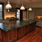 Soapstone Kitchen Island Window Period Style Cabinets Wood Floor Shelf Hanging Lamps