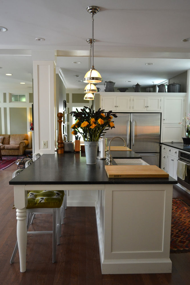 soapstone kitchen island wood floor carpet hanging lamps traditional design chair cabinets ceiling lights