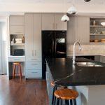 soapstone kitchen island wood floor chairs stove wall cabinet modern kitchen painting door