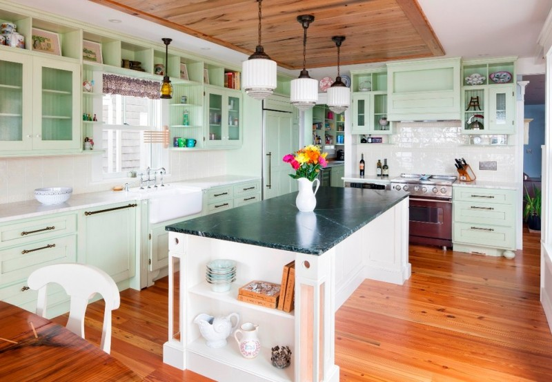 soapstone kitchen island wood floor light green cabinets chair table drawers beach style room hanging lamps
