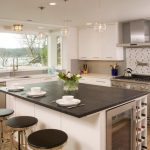 soapstone kitchen island wood floor shelves cabinet dining chairs table small wall tile contemporary room