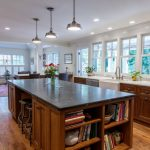 soapstone kitchen island wood floor windows chairs cabinets carpet ceiling lamps
