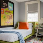 stylish bedroom design with kids carpet bed pillow painting window table books lamp