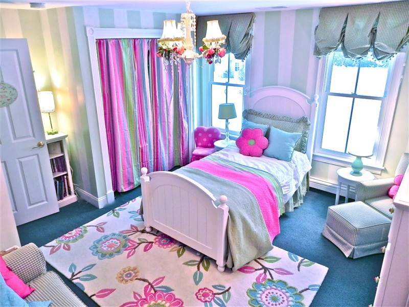 stylish bedroom design with kids carpet floral patterns windows lamps sofa pillows chair colorful bed curtains contemporary room bookshelves