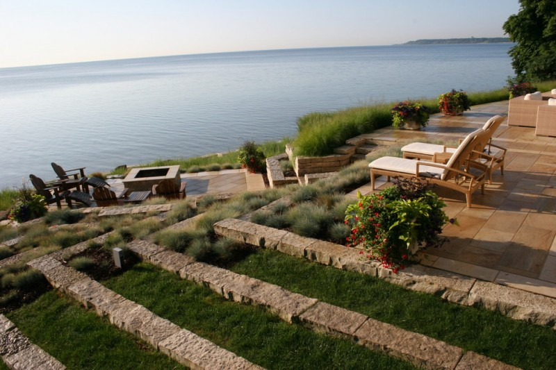 terrace color house contemporary landscape chairs fireplace stone grass flowers green red brown lake view