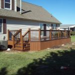 Traditional Deck With Darker Wood Rails And Stairs And Also Vertical Wood Board Deck Skirt