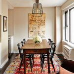 traditional dining room bright colour schemes carpet dark hardwood floor chair pillow table chairs hanging lamp flowers window paintings