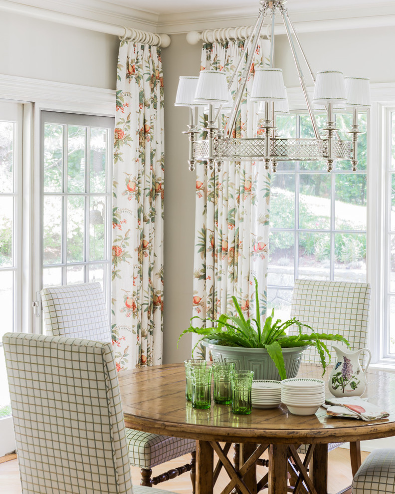 traditional dining room bright colour schemes chairs table glasses plant windows chandelier curtains